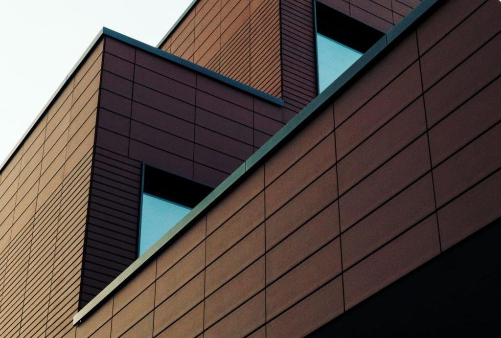 low-angle-photo-of-brown-building-2479178